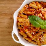 rigatoni and tomato sauce in white bowl