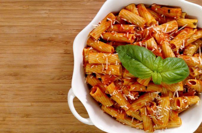 rigatoni and tomato sauce in white bowl