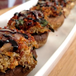 Bacon Stuffed Mushrooms in row on plate