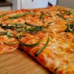 Thin Crust Pizza with cheese and basil