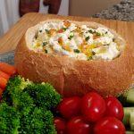 vegetable dip in a bread bowl
