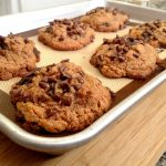 Gluten-Free Peanut Butter Chocolate Chunk Cookies on a cookie sheet
