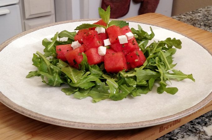 Arugula, watermelon, feta cheese salad on a plate