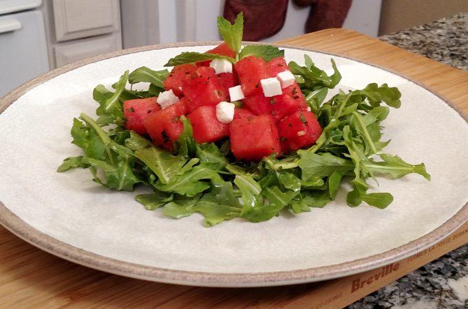 Arugula, watermelon, feta cheese salad on a plate