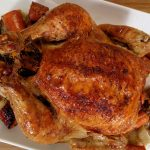 roasted chicken with vegetables on a plate