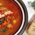 Mom's Vegetable Soup in a bowl, grilled bread, thyme