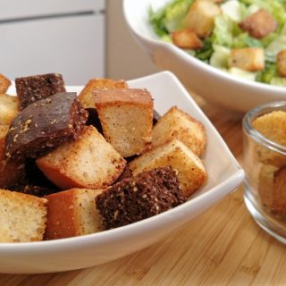 croutons in a bowl with caesar salad