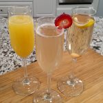 sparkling cocktails, morning mimosa, tiny kitchen bay berry fizz, champagne cocktail on bamboo cutting board