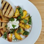 Grilled Summer Peach Salad // Tiny Kitchen Big Taste on white plate with burrata cheese and grilled bread