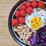 Farro Grain Bowl with Purple Kale, Cherry Tomatoes, Cannellini Bean and a Fried Egg