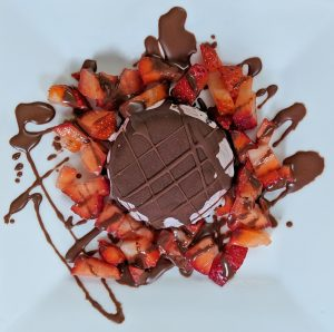 Mini Oreo Cookie Ice Cream Pie with Chocolate Shell Topping and Strawberries on a Plate