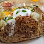 Loaded Baked Potato on a white plate