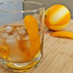 Old Fashioned Cocktail in Double Rocks Glass with Orange Zest