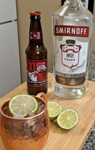 Moscow Mule, Smirnoff Vodka, Cock'n Bull Ginger Beer, Lime on Bamboo Cutting board