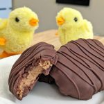 Keto Reese's Peanut Butter Cups on a white plate in egg shape with chicks