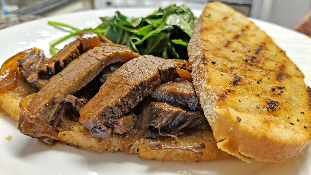 brisket sandwich with toasted bread and spinach