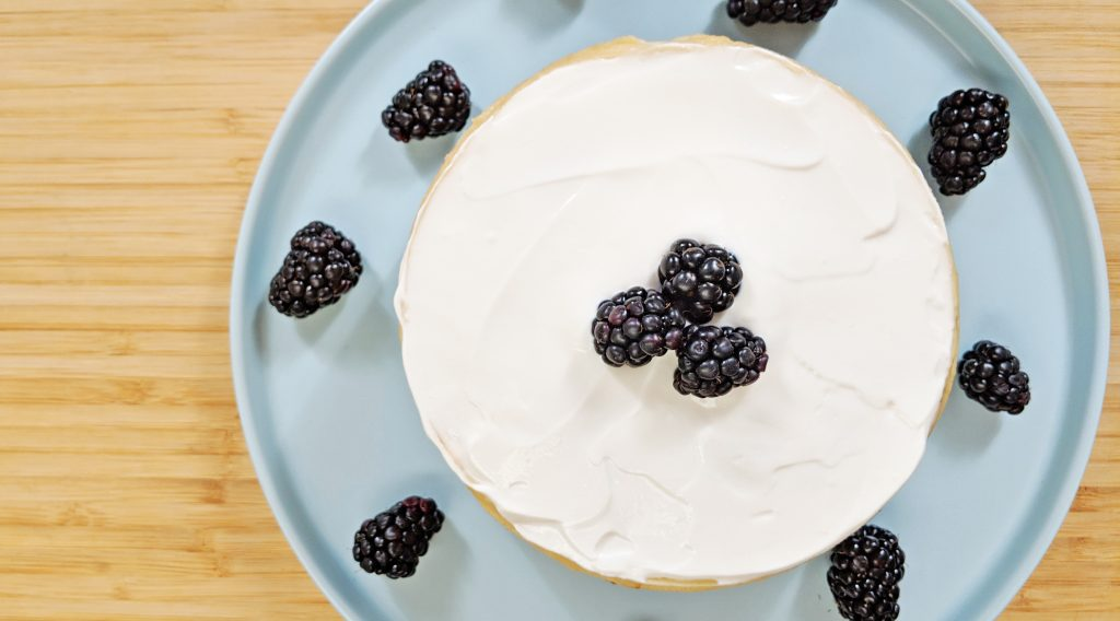 Top view of Cheesecake on Bamboo Cutting Board