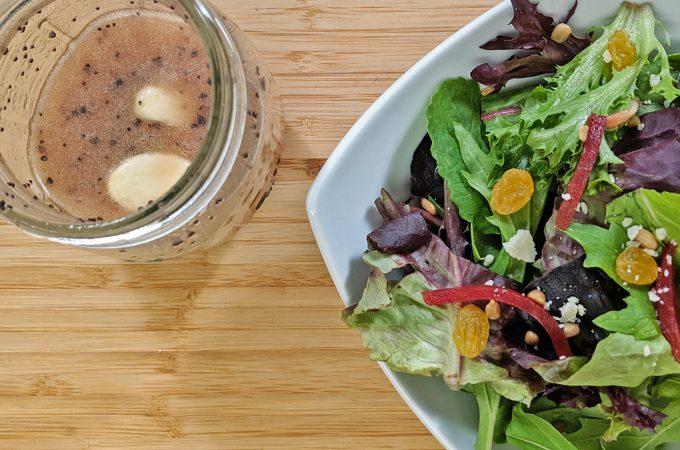 Salad with bottle of salad dressing