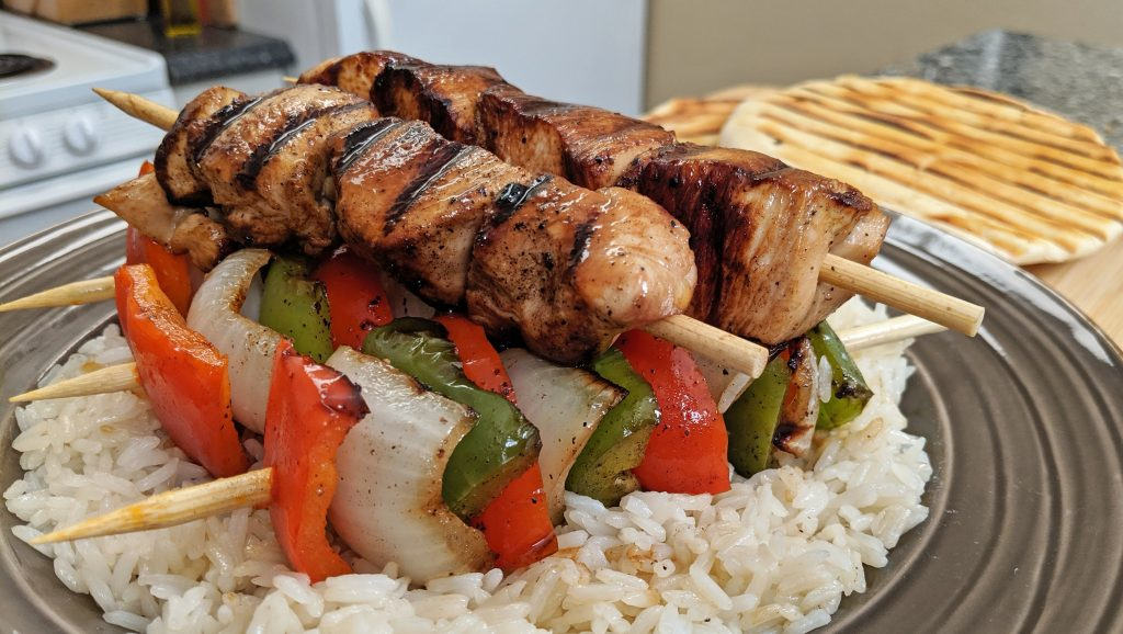 stacks of kabobs on rice